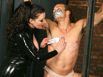 Domme Anastasia Pierce bounds her naughty male submissive and locks him on a cage